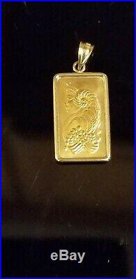 14k gold bezel with 24k gold plated 2.5 gram pamp suisse bar