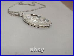 Suisse Rose Rosa One Ounce. 999 Fine Silver Oval Pendant Bar